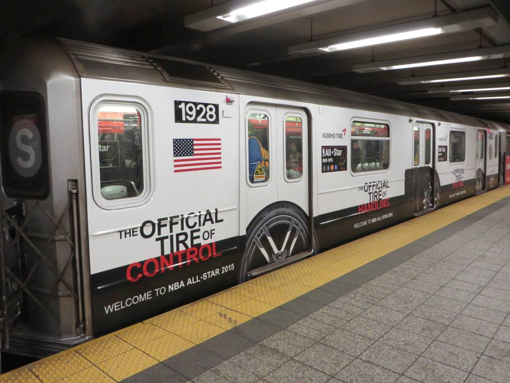 (126k, 1024x768)<br><b>Country:</b> United States<br><b>City:</b> New York<br><b>System:</b> New York City Transit<br><b>Line:</b> IRT Times Square-Grand Central Shuttle<br><b>Location:</b> Grand Central <br><b>Route:</b> S<br><b>Car:</b> R-62A (Bombardier, 1984-1987)  1928 <br><b>Photo by:</b> Robbie Rosenfeld<br><b>Date:</b> 1/26/2015<br><b>Notes:</b> Kumho Tire/NBA All Star wrap<br><b>Viewed (this week/total):</b> 1 / 1075