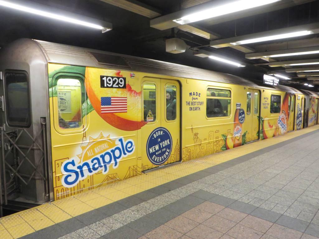 (128k, 1024x768)<br><b>Country:</b> United States<br><b>City:</b> New York<br><b>System:</b> New York City Transit<br><b>Line:</b> IRT Times Square-Grand Central Shuttle<br><b>Location:</b> Grand Central<br><b>Route:</b> S<br><b>Car:</b> R-62A (Bombardier, 1984-1987) 1929 <br><b>Photo by:</b> Robbie Rosenfeld<br><b>Date:</b> 2/3/2015<br><b>Notes:</b> Snapple wrap<br><b>Viewed (this week/total):</b> 0 / 1044