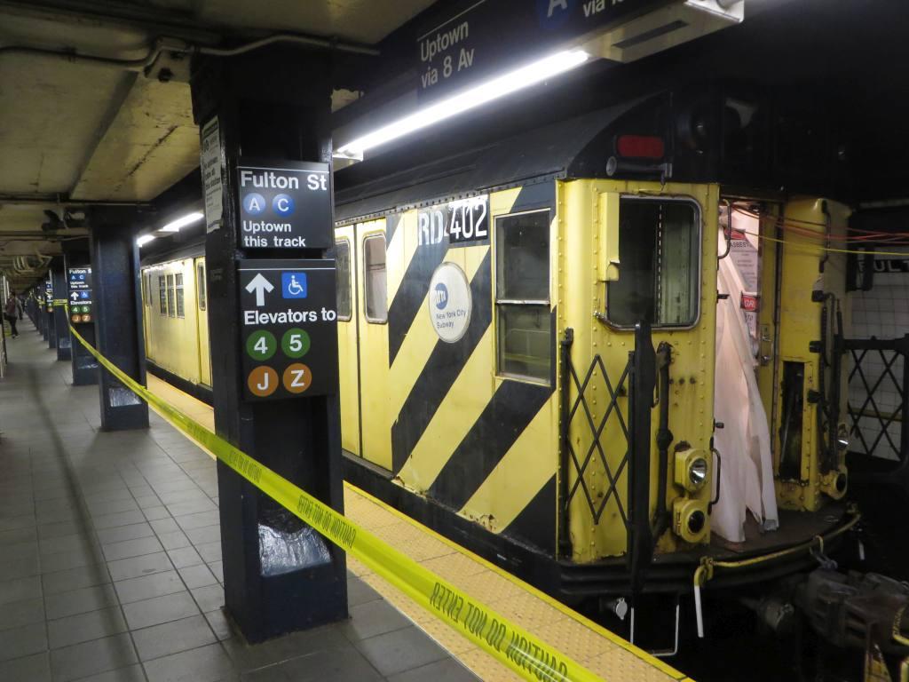 (118k, 1024x768)<br><b>Country:</b> United States<br><b>City:</b> New York<br><b>System:</b> New York City Transit<br><b>Line:</b> IND 8th Avenue Line<br><b>Location:</b> Fulton Street (Broadway/Nassau) <br><b>Route:</b> Work Service<br><b>Car:</b> R-161 Rider Car (ex-R-33)  RD402 <br><b>Photo by:</b> Robbie Rosenfeld<br><b>Date:</b> 10/26/2014<br><b>Viewed (this week/total):</b> 1 / 1607