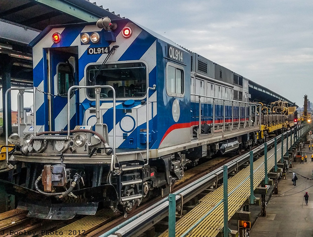 (404k, 1024x776)<br><b>Country:</b> United States<br><b>City:</b> New York<br><b>System:</b> New York City Transit<br><b>Line:</b> BMT Myrtle Avenue Line<br><b>Location:</b> Wyckoff Avenue <br><b>Route:</b> Work Service<br><b>Car:</b> R-156 Diesel-Electric Locomotive (MPI, 2012-2013) 914 <br><b>Photo by:</b> John Dooley<br><b>Date:</b> 6/4/2017<br><b>Viewed (this week/total):</b> 1 / 582