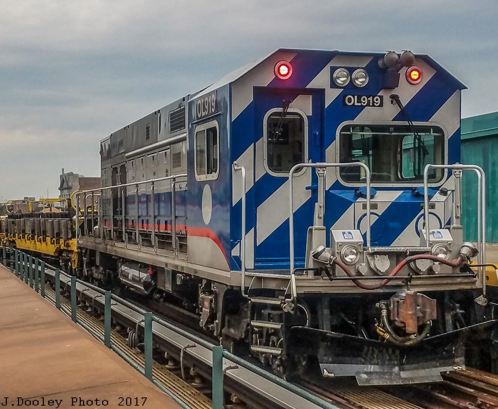 (338k, 1024x841)<br><b>Country:</b> United States<br><b>City:</b> New York<br><b>System:</b> New York City Transit<br><b>Line:</b> BMT Myrtle Avenue Line<br><b>Location:</b> Wyckoff Avenue <br><b>Route:</b> Work Service<br><b>Car:</b> R-156 Diesel-Electric Locomotive (MPI, 2012-2013) 919 <br><b>Photo by:</b> John Dooley<br><b>Date:</b> 6/4/2017<br><b>Viewed (this week/total):</b> 1 / 526