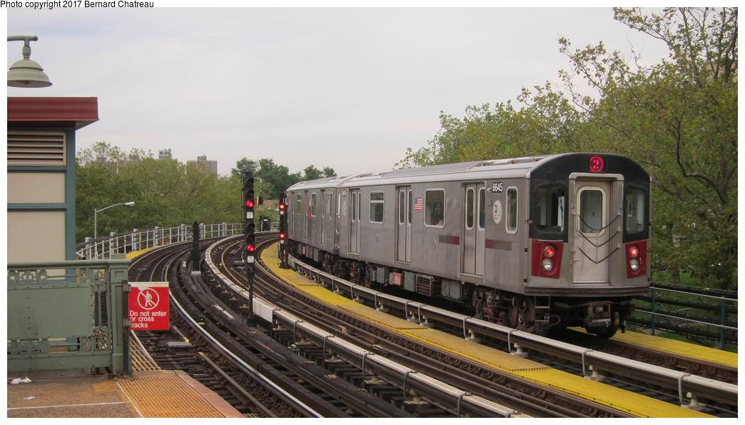 (263k, 1044x595)<br><b>Country:</b> United States<br><b>City:</b> New York<br><b>System:</b> New York City Transit<br><b>Line:</b> IRT White Plains Road Line<br><b>Location:</b> Jackson Avenue <br><b>Route:</b> 2<br><b>Car:</b> R-142 (Primary Order, Bombardier, 1999-2002)  6645 <br><b>Photo by:</b> Bernard Chatreau<br><b>Date:</b> 9/24/2011<br><b>Viewed (this week/total):</b> 3 / 392