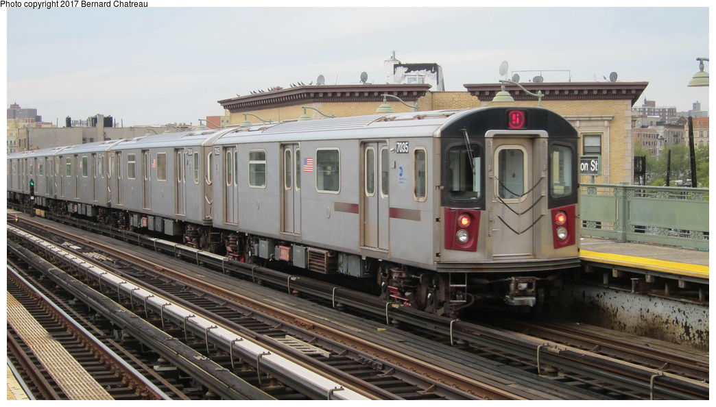 (252k, 1044x594)<br><b>Country:</b> United States<br><b>City:</b> New York<br><b>System:</b> New York City Transit<br><b>Line:</b> IRT White Plains Road Line<br><b>Location:</b> Simpson Street <br><b>Route:</b> 5<br><b>Car:</b> R-142 (Option Order, Bombardier, 2002-2003)  7035 <br><b>Photo by:</b> Bernard Chatreau<br><b>Date:</b> 9/24/2011<br><b>Viewed (this week/total):</b> 1 / 528