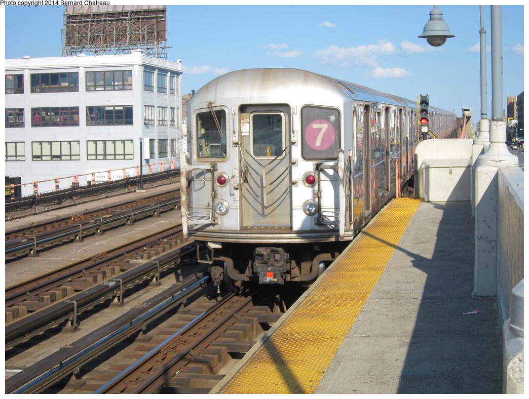 (339k, 1044x788)<br><b>Country:</b> United States<br><b>City:</b> New York<br><b>System:</b> New York City Transit<br><b>Line:</b> IRT Flushing Line<br><b>Location:</b> 33rd Street/Rawson Street <br><b>Route:</b> 7<br><b>Car:</b> R-62A (Bombardier, 1984-1987)   <br><b>Photo by:</b> Bernard Chatreau<br><b>Date:</b> 4/17/2011<br><b>Viewed (this week/total):</b> 2 / 427