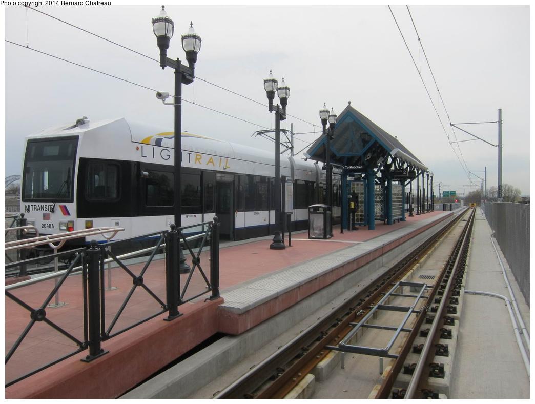 (256k, 1044x788)<br><b>Country:</b> United States<br><b>City:</b> Jersey City, NJ<br><b>System:</b> Hudson Bergen Light Rail<br><b>Location:</b> Bayonne 8th Street<br><b>Car:</b> NJT-HBLR LRV (Kinki-Sharyo, 1998-99) 2048 <br><b>Photo by:</b> Bernard Chatreau<br><b>Date:</b> 4/18/2011<br><b>Viewed (this week/total):</b> 1 / 213