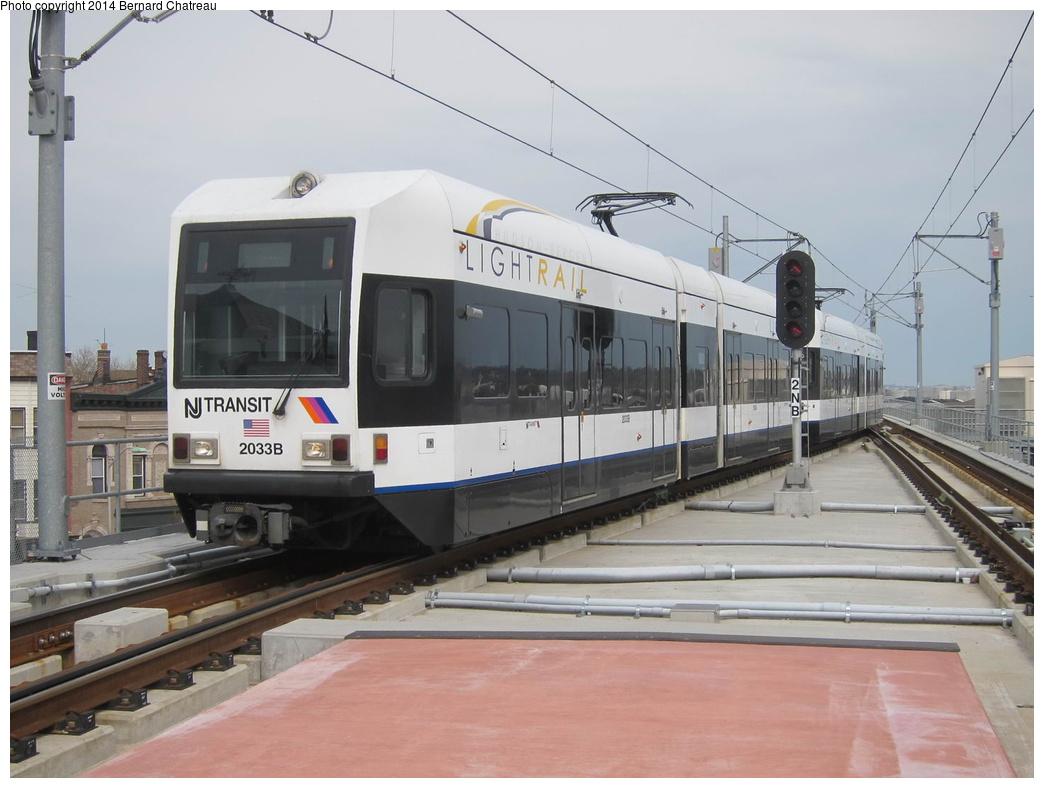 (254k, 1044x788)<br><b>Country:</b> United States<br><b>City:</b> Jersey City, NJ<br><b>System:</b> Hudson Bergen Light Rail<br><b>Location:</b> Bayonne 8th Street<br><b>Car:</b> NJT-HBLR LRV (Kinki-Sharyo, 1998-99) 2033 <br><b>Photo by:</b> Bernard Chatreau<br><b>Date:</b> 4/18/2011<br><b>Viewed (this week/total):</b> 3 / 254