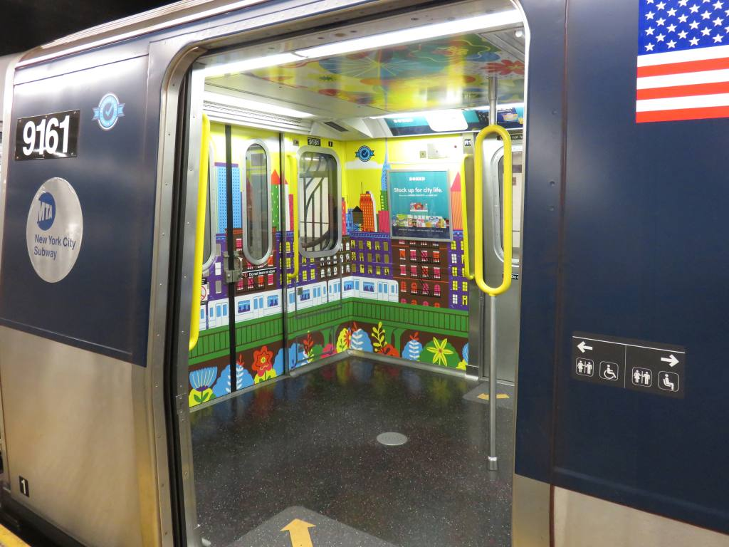 (120k, 1024x768)<br><b>Country:</b> United States<br><b>City:</b> New York<br><b>System:</b> New York City Transit<br><b>Line:</b> IND 8th Avenue Line<br><b>Location:</b> Chambers Street/World Trade Center <br><b>Car:</b> R-160B (Option 1) (Kawasaki, 2008-2009)  9161 <br><b>Photo by:</b> Robbie Rosenfeld<br><b>Date:</b> 10/18/2017<br><b>Notes:</b> R-160 train with experimental extra standing room (i.e. some seats removed)<br><b>Viewed (this week/total):</b> 1 / 235