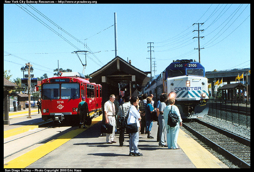 (179k, 824x558)<br><b>Country:</b> United States<br><b>City:</b> San Diego, CA<br><b>System:</b> San Diego Trolley<br><b>Line:</b> San Diego Trolley-Blue Line<br><b>Location:</b> Old Town <br><b>Car:</b> Siemens U2  1014 <br><b>Photo by:</b> Eric Haas<br><b>Date:</b> 7/19/2000<br><b>Notes:</b> The trolley on the left will return to the border. The Coaster train is going to Oceanside.<br><b>Viewed (this week/total):</b> 0 / 4173