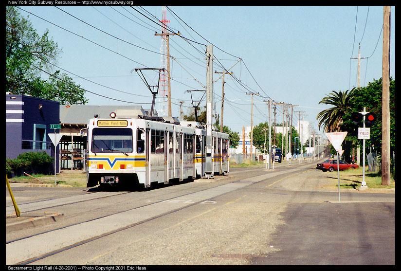 (157k, 824x557)<br><b>Country:</b> United States<br><b>City:</b> Sacramento, CA<br><b>System:</b> SACRT Light Rail<br><b>Location:</b> 23rd Street <br><b>Photo by:</b> Eric Haas<br><b>Date:</b> 4/28/2001<br><b>Notes:</b> Train about the leave single track Bee Bridge.  The Sacramento Bee Building is at the right.<br><b>Viewed (this week/total):</b> 0 / 1974
