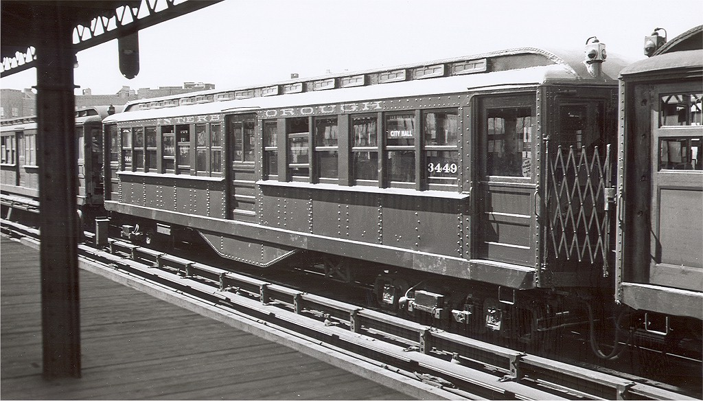 (210k, 1024x584)<br><b>Country:</b> United States<br><b>City:</b> New York<br><b>System:</b> New York City Transit<br><b>Line:</b> IRT Pelham Line<br><b>Car:</b> Hi-V 3449 <br><b>Collection of:</b> Joe Testagrose<br><b>Notes:</b> Pelham line, between 1937 and 1945. White line under car number indicates center door cut-out modification. Note sign - City Hall (elevated) destination - service abandoned 12/31/1945.<br><b>Viewed (this week/total):</b> 2 / 2822