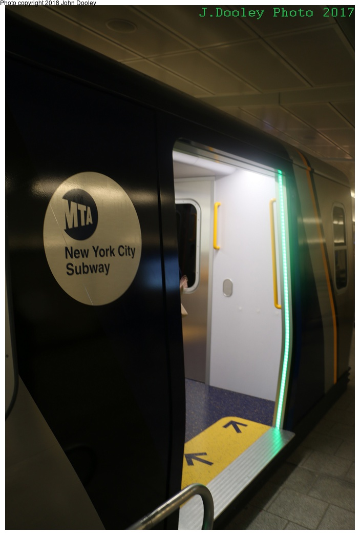 (144k, 703x1044)<br><b>Country:</b> United States<br><b>City:</b> New York<br><b>System:</b> New York City Transit<br><b>Line:</b> IRT Flushing Line<br><b>Location:</b> 34th Street-Hudson Yards <br><b>Photo by:</b> John Dooley<br><b>Date:</b> 12/1/2017<br><b>Notes:</b> R-211 mockup on display at 34th St-Hudson Yards mezzanine.<br><b>Viewed (this week/total):</b> 13 / 382