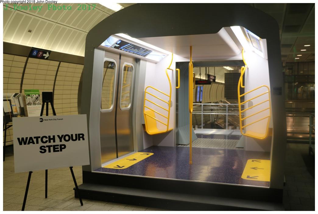 (211k, 1044x703)<br><b>Country:</b> United States<br><b>City:</b> New York<br><b>System:</b> New York City Transit<br><b>Line:</b> IRT Flushing Line<br><b>Location:</b> 34th Street-Hudson Yards <br><b>Photo by:</b> John Dooley<br><b>Date:</b> 12/1/2017<br><b>Notes:</b> R-211 mockup on display at 34th St-Hudson Yards mezzanine.<br><b>Viewed (this week/total):</b> 0 / 546