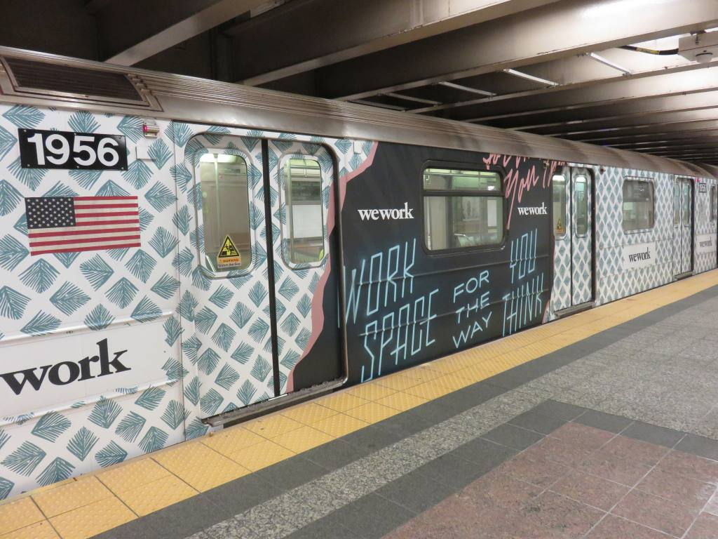 (144k, 1024x768)<br><b>Country:</b> United States<br><b>City:</b> New York<br><b>System:</b> New York City Transit<br><b>Line:</b> IRT Times Square-Grand Central Shuttle<br><b>Location:</b> Grand Central <br><b>Route:</b> S<br><b>Car:</b> R-62A (Bombardier, 1984-1987)  1956 <br><b>Photo by:</b> Robbie Rosenfeld<br><b>Date:</b> 9/6/2017<br><b>Notes:</b> WeWork ad wrap<br><b>Viewed (this week/total):</b> 1 / 452