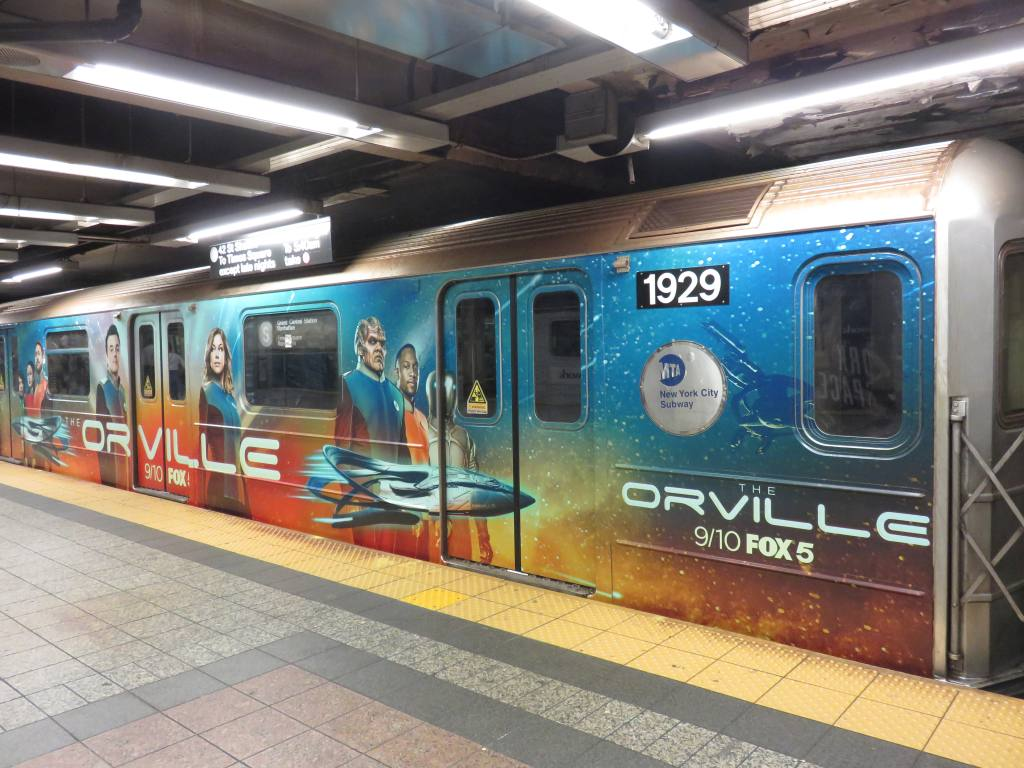 (136k, 1024x768)<br><b>Country:</b> United States<br><b>City:</b> New York<br><b>System:</b> New York City Transit<br><b>Line:</b> IRT Times Square-Grand Central Shuttle<br><b>Location:</b> Grand Central <br><b>Route:</b> S<br><b>Car:</b> R-62A (Bombardier, 1984-1987)  1929 <br><b>Photo by:</b> Robbie Rosenfeld<br><b>Date:</b> 9/4/2017<br><b>Notes:</b> The Orville ad wrap<br><b>Viewed (this week/total):</b> 20 / 372