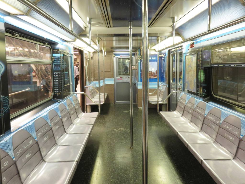 (144k, 1024x768)<br><b>Country:</b> United States<br><b>City:</b> New York<br><b>System:</b> New York City Transit<br><b>Line:</b> IRT Times Square-Grand Central Shuttle<br><b>Location:</b> Grand Central <br><b>Route:</b> S<br><b>Car:</b> R-62A (Bombardier, 1984-1987)  1945 <br><b>Photo by:</b> Robbie Rosenfeld<br><b>Date:</b> 9/6/2017<br><b>Notes:</b> The Orville ad wrap<br><b>Viewed (this week/total):</b> 5 / 160