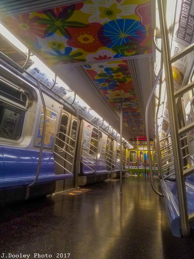 (301k, 768x1025)<br><b>Country:</b> United States<br><b>City:</b> New York<br><b>System:</b> New York City Transit<br><b>Route:</b> E<br><b>Car:</b> R-160A (Option 2) (Alstom, 2009, 5-car sets)  9735 <br><b>Photo by:</b> John Dooley<br><b>Date:</b> 10/6/2017<br><b>Notes:</b> Car interior modifications<br><b>Viewed (this week/total):</b> 0 / 477