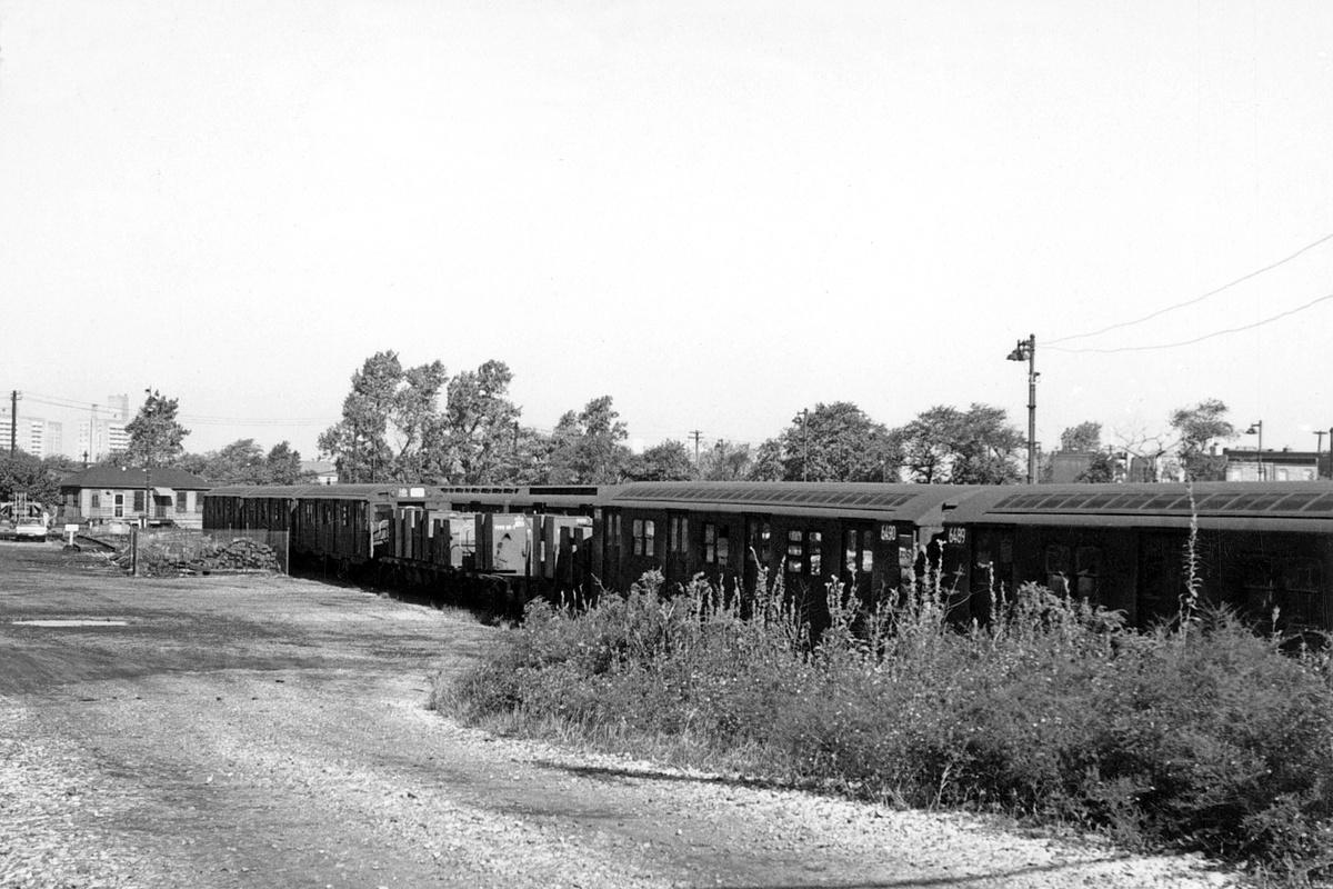 (347k, 1200x800)<br><b>Country:</b> United States<br><b>City:</b> New York<br><b>System:</b> New York City Transit<br><b>Location:</b> Rockaway Parkway (Canarsie) Yard<br><b>Car:</b> R-16 (American Car & Foundry, 1955) 6490-6489 <br><b>Collection of:</b> David Pirmann<br><b>Date:</b> 9/30/1962<br><b>Notes:</b> With garbage train at Canarsie Yard<br><b>Viewed (this week/total):</b> 3 / 205