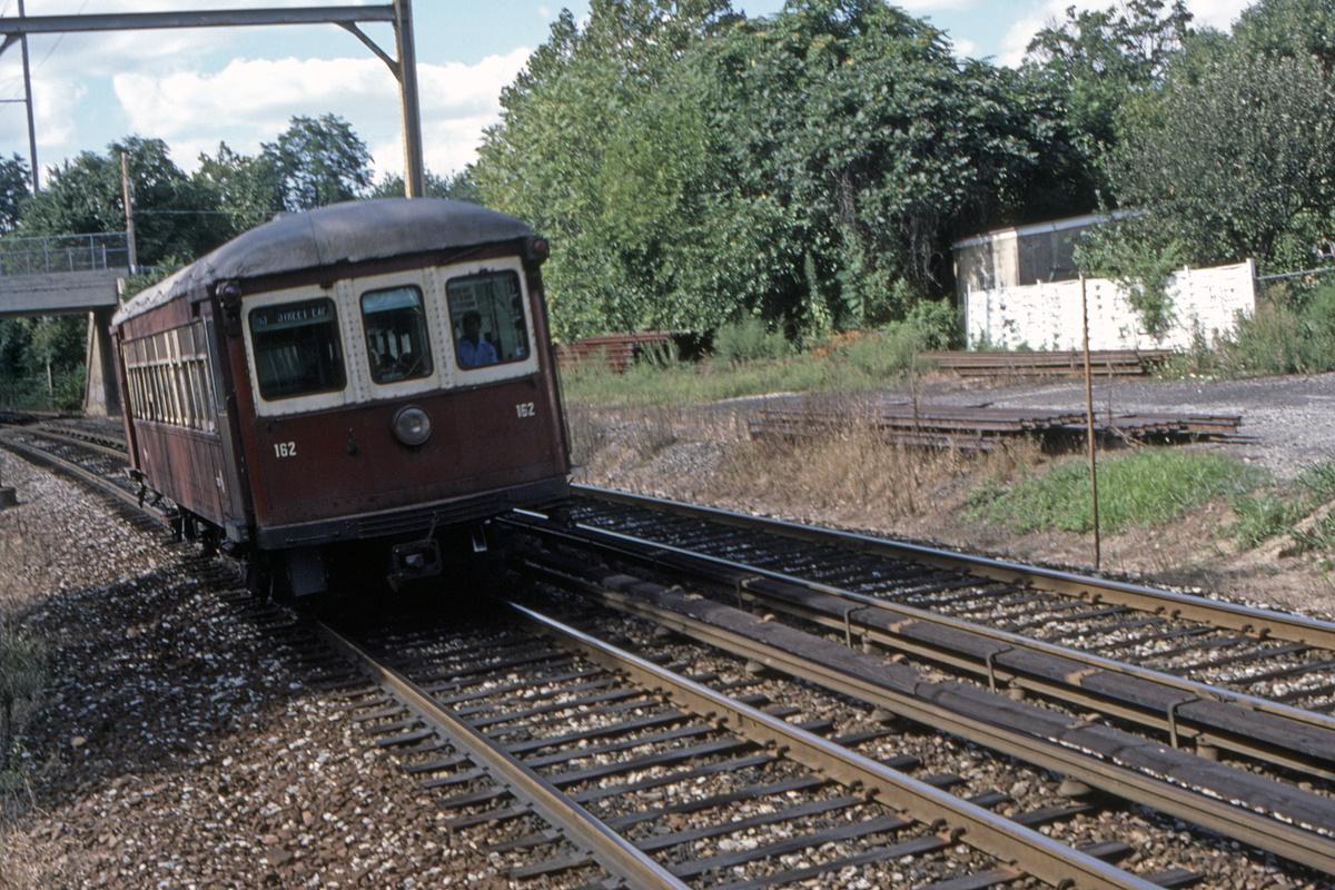 (637k, 1200x800)<br><b>Country:</b> United States<br><b>City:</b> Philadelphia, PA<br><b>System:</b> SEPTA (or Predecessor)<br><b>Line:</b> 100-Norristown<br><b>Location:</b> Norristown line-Loc. unknown.<br><b>Car:</b> PSTC/SEPTA Strafford (J.G. Brill Co., 1927-1929) 162 <br><b>Collection of:</b> David Pirmann<br><b>Date:</b> 8/1987<br><b>Viewed (this week/total):</b> 2 / 35