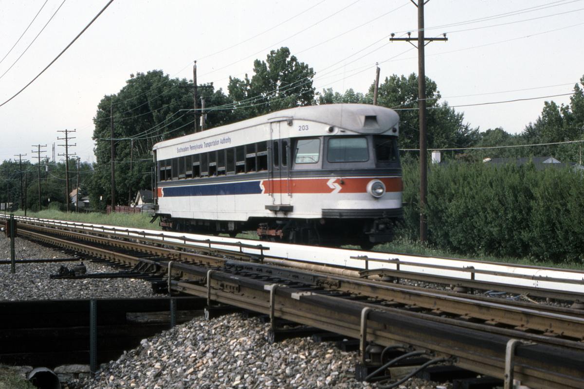 (468k, 1200x800)<br><b>Country:</b> United States<br><b>City:</b> Philadelphia, PA<br><b>System:</b> SEPTA (or Predecessor)<br><b>Line:</b> 100-Norristown<br><b>Location:</b> Norristown line-Loc. unknown.<br><b>Car:</b> PSTC/SEPTA Bullet (J.G. Brill Co., 1931-1934) 203 <br><b>Collection of:</b> David Pirmann<br><b>Date:</b> 9/1987<br><b>Viewed (this week/total):</b> 2 / 33