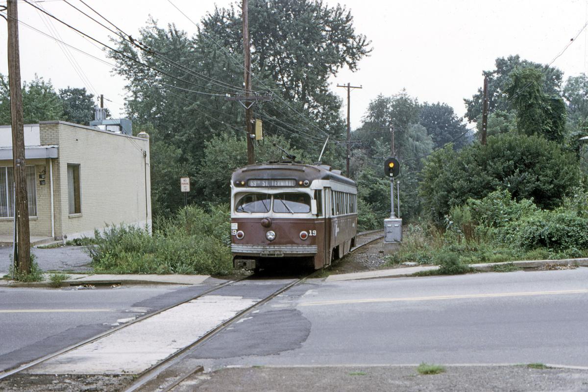 (592k, 1200x800)<br><b>Country:</b> United States<br><b>City:</b> Philadelphia, PA<br><b>System:</b> SEPTA (or Predecessor)<br><b>Line:</b> Rt. 101-Media<br><b>Location:</b> Woodland Avenue<br><b>Car:</b> PSTC Streamliner (St. Louis Car Co., 1949) 19 <br><b>Collection of:</b> David Pirmann<br><b>Date:</b> 8/1974<br><b>Viewed (this week/total):</b> 0 / 58