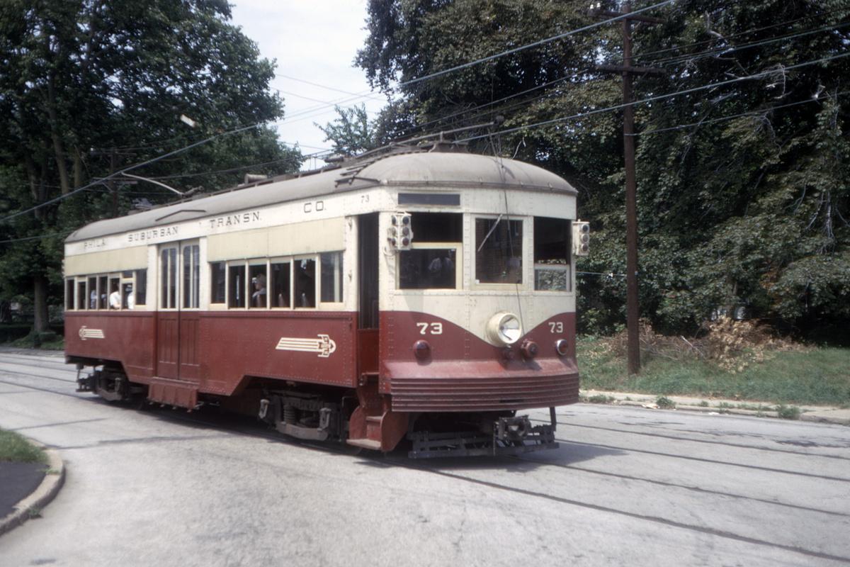 (480k, 1200x800)<br><b>Country:</b> United States<br><b>City:</b> Philadelphia, PA<br><b>System:</b> SEPTA (or Predecessor)<br><b>Line:</b> Rt. 102-Sharon Hill<br><b>Location:</b> Woodlawn Avenue<br><b>Car:</b> PSTC Center Entrance Interurban (J.G. Brill, 1926) 73 <br><b>Collection of:</b> David Pirmann<br><b>Date:</b> 7/1967<br><b>Viewed (this week/total):</b> 0 / 45