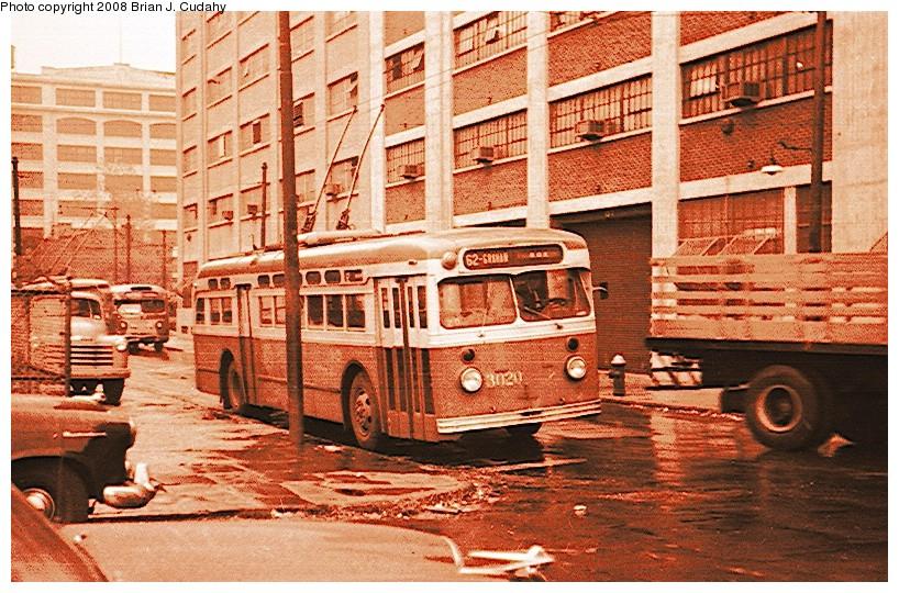 (199k, 818x540)<br><b>Country:</b> United States<br><b>City:</b> New York<br><b>System:</b> B&QT Trolleybus<br><b>Car:</b>  3020 <br><b>Photo by:</b> Brian J. Cudahy<br><b>Notes:</b> St. Louis-built coach No. 3028 on B-62, Graham Avenue Route, at Civic Center, 1955<br><b>Viewed (this week/total):</b> 0 / 1728