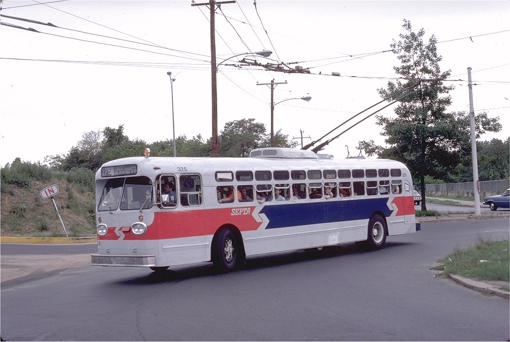 (192k, 1024x688)<br><b>Country:</b> United States<br><b>City:</b> Philadelphia, PA<br><b>System:</b> SEPTA (or Predecessor)<br><b>Line:</b> SEPTA Trackless Trolley Routes<br><b>Route:</b> Rt 75<br><b>Car:</b> PTC/SEPTA Marmon-Herrington TC-49 Trackless (1955) 325 <br><b>Photo by:</b> Steve Zabel<br><b>Collection of:</b> Joe Testagrose<br><b>Date:</b> 8/10/1980<br><b>Notes:</b> Castor & Wyoming Ave<br><b>Viewed (this week/total):</b> 0 / 743
