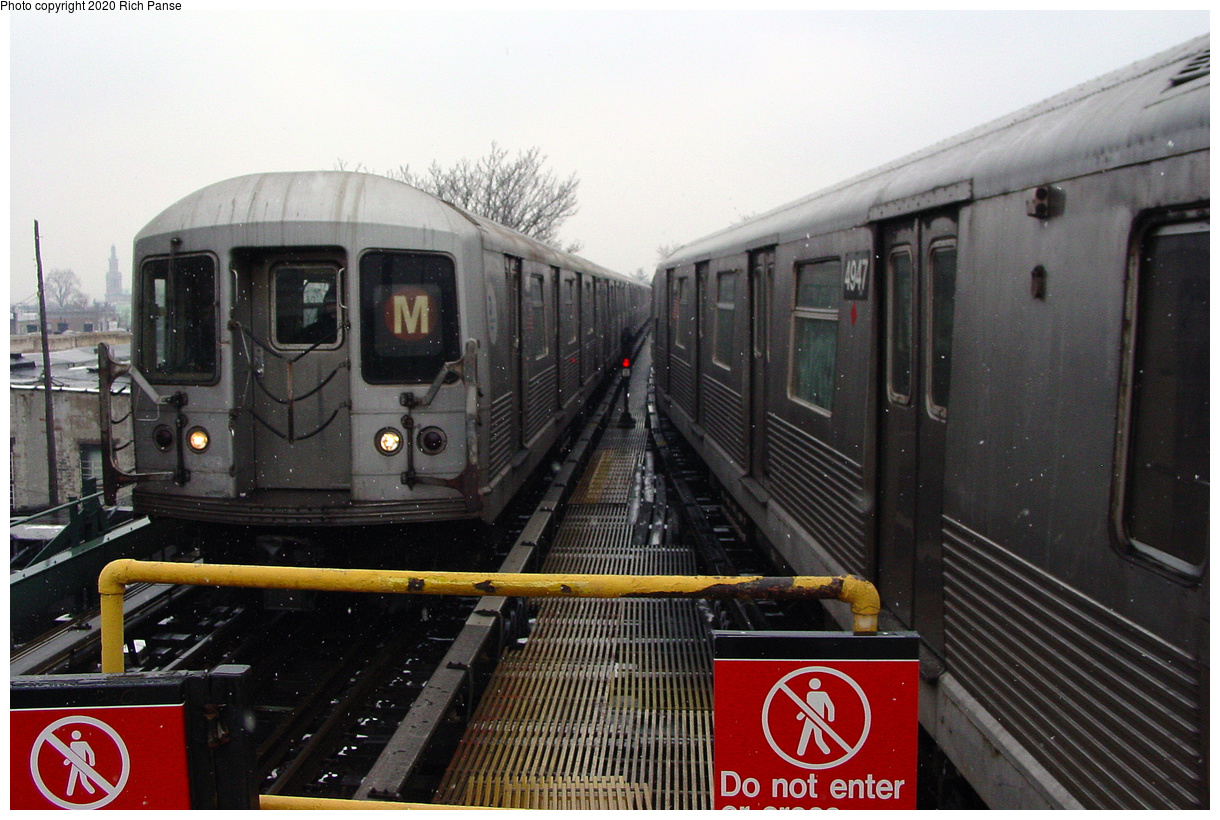 (496k, 1220x820)<br><b>Country:</b> United States<br><b>City:</b> New York<br><b>System:</b> New York City Transit<br><b>Line:</b> BMT Myrtle Avenue Line<br><b>Location:</b> Fresh Pond Road<br><b>Route:</b> M<br><b>Car:</b> R-42 (St. Louis, 1969-1970)  <br><b>Photo by:</b> Richard Panse<br><b>Date:</b> 1/29/2003<br><b>Viewed (this week/total):</b> 50 / 169