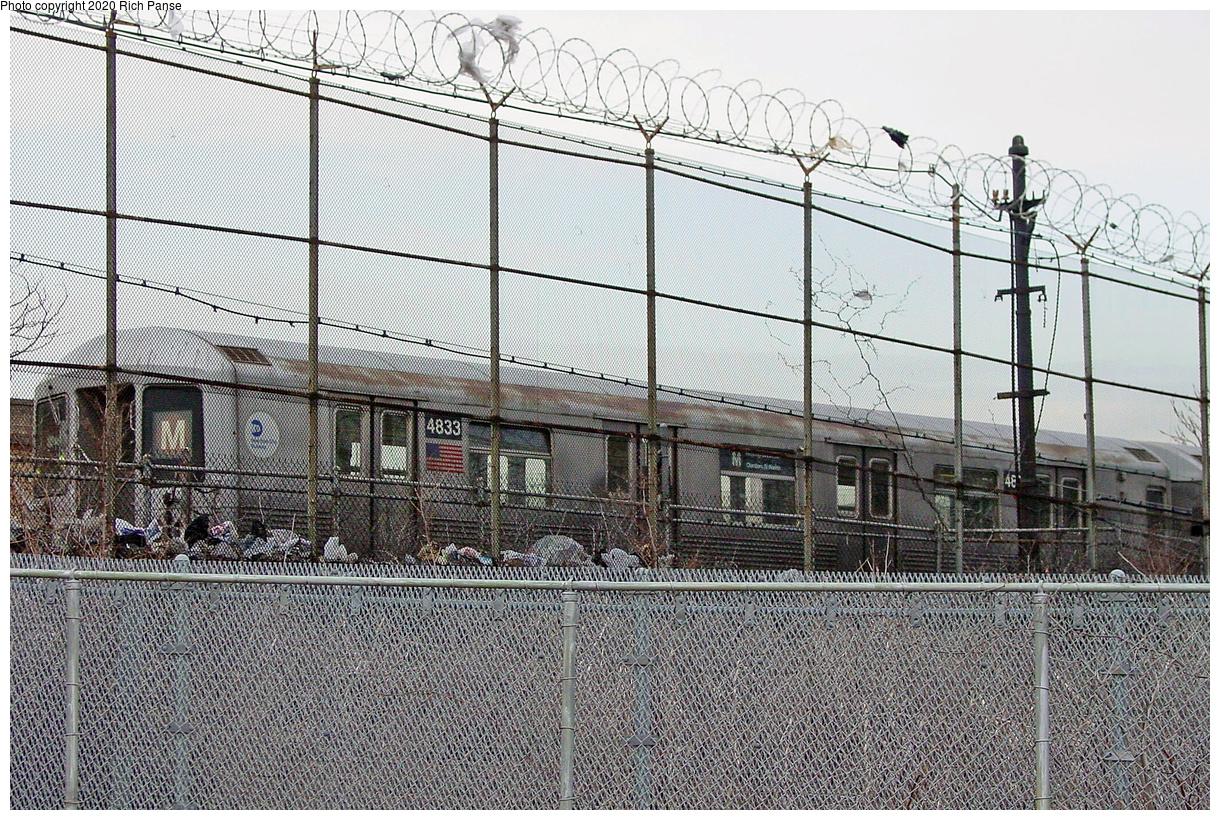 (727k, 1220x820)<br><b>Country:</b> United States<br><b>City:</b> New York<br><b>System:</b> New York City Transit<br><b>Line:</b> BMT Myrtle Avenue Line<br><b>Location:</b> Metropolitan Avenue<br><b>Route:</b> M<br><b>Car:</b> R-42 (St. Louis, 1969-1970) 4833 <br><b>Photo by:</b> Richard Panse<br><b>Date:</b> 3/12/2003<br><b>Viewed (this week/total):</b> 47 / 171