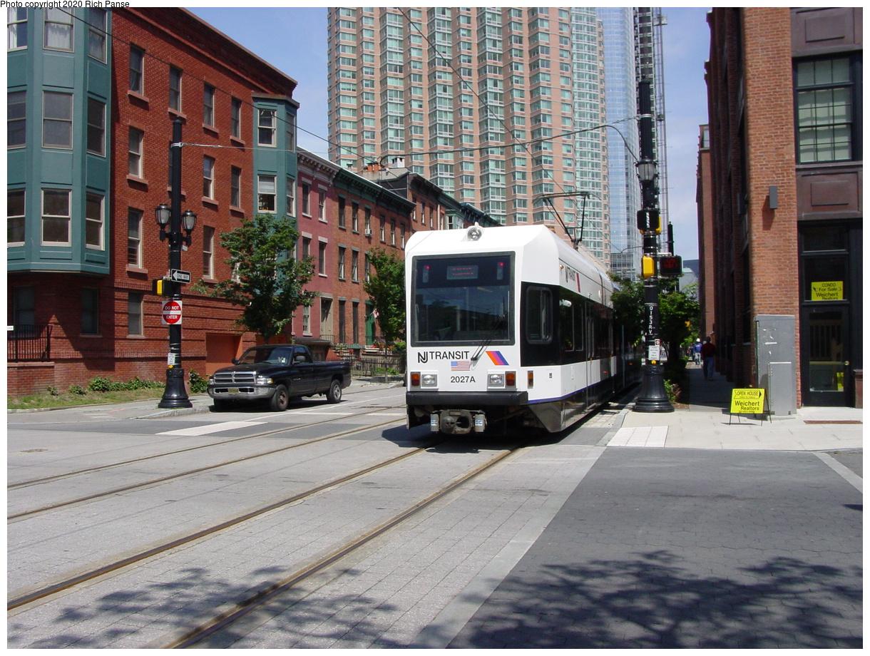 (511k, 1220x920)<br><b>Country:</b> United States<br><b>City:</b> Jersey City, NJ<br><b>System:</b> Hudson Bergen Light Rail<br><b>Location:</b> Along Essex Street<br><b>Car:</b> NJT-HBLR LRV (Kinki-Sharyo, 1998-99) 2027 <br><b>Photo by:</b> Richard Panse<br><b>Date:</b> 6/16/2003<br><b>Viewed (this week/total):</b> 2 / 9