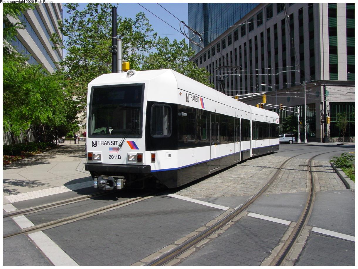 (537k, 1220x920)<br><b>Country:</b> United States<br><b>City:</b> Jersey City, NJ<br><b>System:</b> Hudson Bergen Light Rail<br><b>Location:</b> Exchange Place<br><b>Car:</b> NJT-HBLR LRV (Kinki-Sharyo, 1998-99) 2011 <br><b>Photo by:</b> Richard Panse<br><b>Date:</b> 6/16/2003<br><b>Viewed (this week/total):</b> 3 / 11