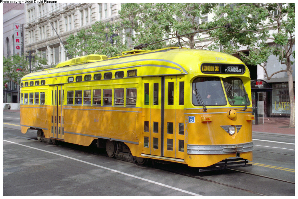 (253k, 1044x700)<br><b>Country:</b> United States<br><b>City:</b> San Francisco/Bay Area, CA<br><b>System:</b> SF MUNI<br><b>Location:</b> Market/4th/Stockton <br><b>Route:</b> F-Market<br><b>Car:</b> SF MUNI PCC (Ex-SEPTA) (St. Louis Car Co., 1947-1948)  1052 <br><b>Photo by:</b> David Pirmann<br><b>Date:</b> 7/4/1996<br><b>Notes:</b> Los Angeles orange and yellow<br><b>Viewed (this week/total):</b> 0 / 4480