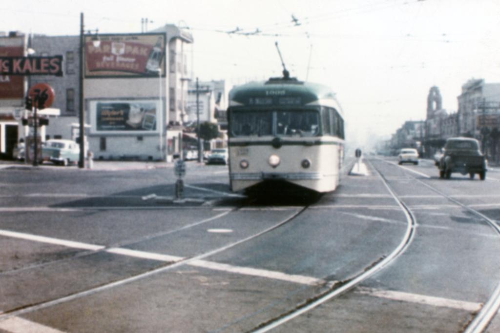 (308k, 1044x700)<br><b>Country:</b> United States<br><b>City:</b> San Francisco/Bay Area, CA<br><b>System:</b> SF MUNI<br><b>Location:</b> Market/17th/Castro <br><b>Route:</b> K-Ingleside<br><b>Car:</b> SF MUNI PCC Torpedo Double-End (St. Louis Car Co., 1948)  1005 <br><b>Photo by:</b> Gary Grahl<br><b>Collection of:</b> David Pirmann<br><b>Date:</b> 9/1972<br><b>Notes:</b> 1938 Magic Carpet PCC-lookalike<br><b>Viewed (this week/total):</b> 2 / 4894