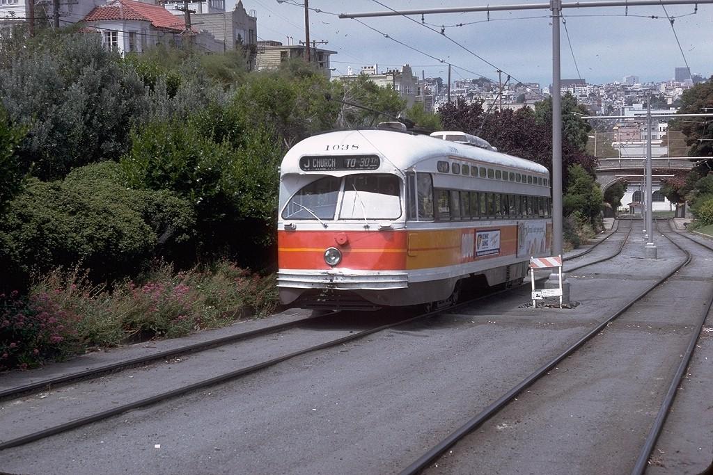 (268k, 1024x683)<br><b>Country:</b> United States<br><b>City:</b> San Francisco/Bay Area, CA<br><b>System:</b> SF MUNI<br><b>Line:</b> MUNI Metro (J-Church)<br><b>Location:</b> Mission Dolores Park <br><b>Route:</b> J-Church<br><b>Car:</b> SF MUNI PCC Baby Ten (St. Louis Car Co, 1951)  1038 <br><b>Photo by:</b> Doug Grotjahn<br><b>Collection of:</b> Joe Testagrose<br><b>Date:</b> 8/4/1979<br><b>Viewed (this week/total):</b> 6 / 3154