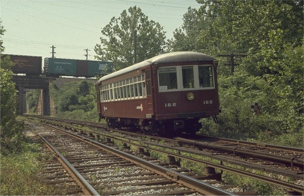 (254k, 1024x661)<br><b>Country:</b> United States<br><b>City:</b> Philadelphia, PA<br><b>System:</b> SEPTA (or Predecessor)<br><b>Line:</b> 100-Norristown<br><b>Location:</b> King Manor <br><b>Car:</b> PSTC/SEPTA Strafford (J.G. Brill Co., 1927-1929)  162 <br><b>Photo by:</b> Joe Testagrose<br><b>Date:</b> 5/29/1970<br><b>Notes:</b> South of King Manor Station, view facing south at PRR underpass (E. Church Road underpass beyond).<br><b>Viewed (this week/total):</b> 1 / 2837