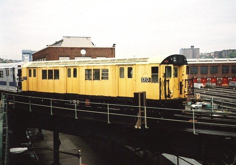 (196k, 800x561)<br><b>Country:</b> United States<br><b>City:</b> New York<br><b>System:</b> New York City Transit<br><b>Location:</b> 207th Street Yard<br><b>Route:</b> Fan Trip<br><b>Car:</b> R-22 (St. Louis, 1957-58) 37371 <br><b>Photo by:</b> Gary Chatterton<br><b>Date:</b> 5/1/2005<br><b>Notes:</b> Work Motor 37371 before fantrip, leaving 207th St. Yard.<br><b>Viewed (this week/total):</b> 0 / 2401