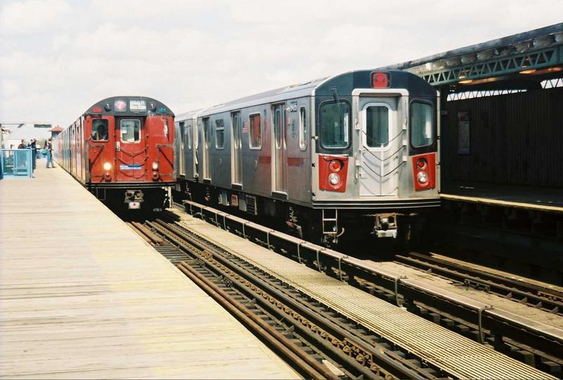 (74k, 800x540)<br><b>Country:</b> United States<br><b>City:</b> New York<br><b>System:</b> New York City Transit<br><b>Line:</b> IRT White Plains Road Line<br><b>Location:</b> 238th Street (Nereid Avenue) <br><b>Route:</b> Fan Trip<br><b>Car:</b> R-33 World's Fair (St. Louis, 1963-64) 9327 <br><b>Photo by:</b> Gary Chatterton<br><b>Date:</b> 5/1/2005<br><b>Notes:</b> With R142 6435<br><b>Viewed (this week/total):</b> 0 / 4346