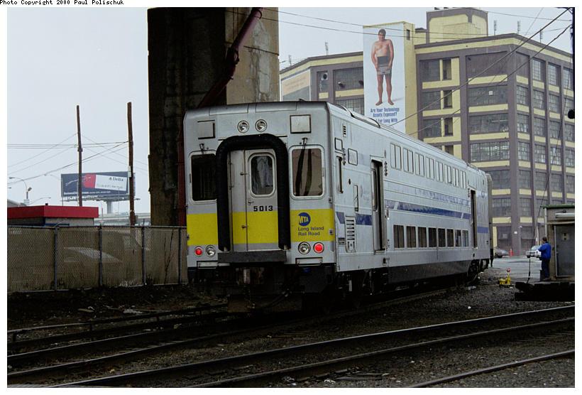 (91k, 820x556)<br><b>Country:</b> United States<br><b>City:</b> New York<br><b>System:</b> Long Island Rail Road<br><b>Line:</b> LIRR Long Island City<br><b>Location:</b> Long Island City <br><b>Car:</b> LIRR Kawasaki C-3/C-R (Bilevel Coach/Cab) 5013 <br><b>Photo by:</b> Paul Polischuk<br><b>Date:</b> 5/2000<br><b>Viewed (this week/total):</b> 1 / 3956