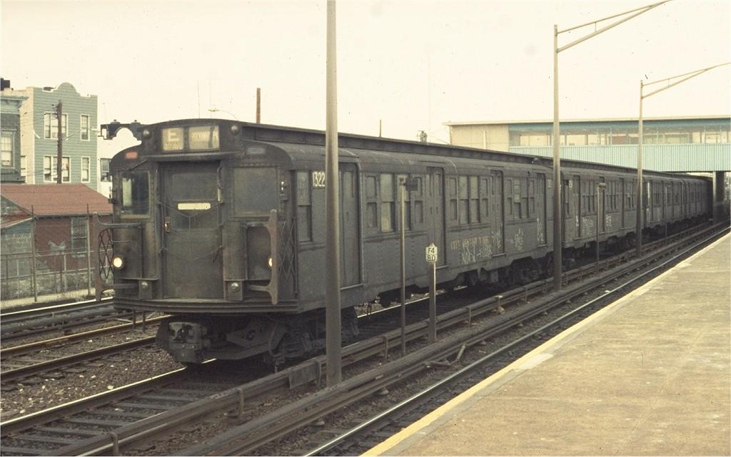 (165k, 1024x641)<br><b>Country:</b> United States<br><b>City:</b> New York<br><b>System:</b> New York City Transit<br><b>Line:</b> IND Rockaway<br><b>Location:</b> Howard Beach <br><b>Route:</b> E<br><b>Car:</b> R-6-1 (Pressed Steel, 1936)  1322 <br><b>Photo by:</b> Ed McKernan<br><b>Collection of:</b> Joe Testagrose<br><b>Date:</b> 2/1975<br><b>Viewed (this week/total):</b> 2 / 3724
