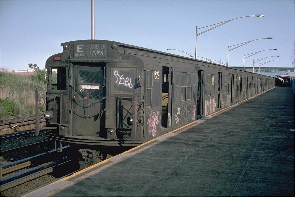 (215k, 1024x686)<br><b>Country:</b> United States<br><b>City:</b> New York<br><b>System:</b> New York City Transit<br><b>Line:</b> IND Rockaway<br><b>Location:</b> Howard Beach <br><b>Route:</b> E<br><b>Car:</b> R-6-1 (Pressed Steel, 1936)  1322 <br><b>Photo by:</b> Doug Grotjahn<br><b>Collection of:</b> Joe Testagrose<br><b>Date:</b> 6/4/1976<br><b>Viewed (this week/total):</b> 0 / 8901