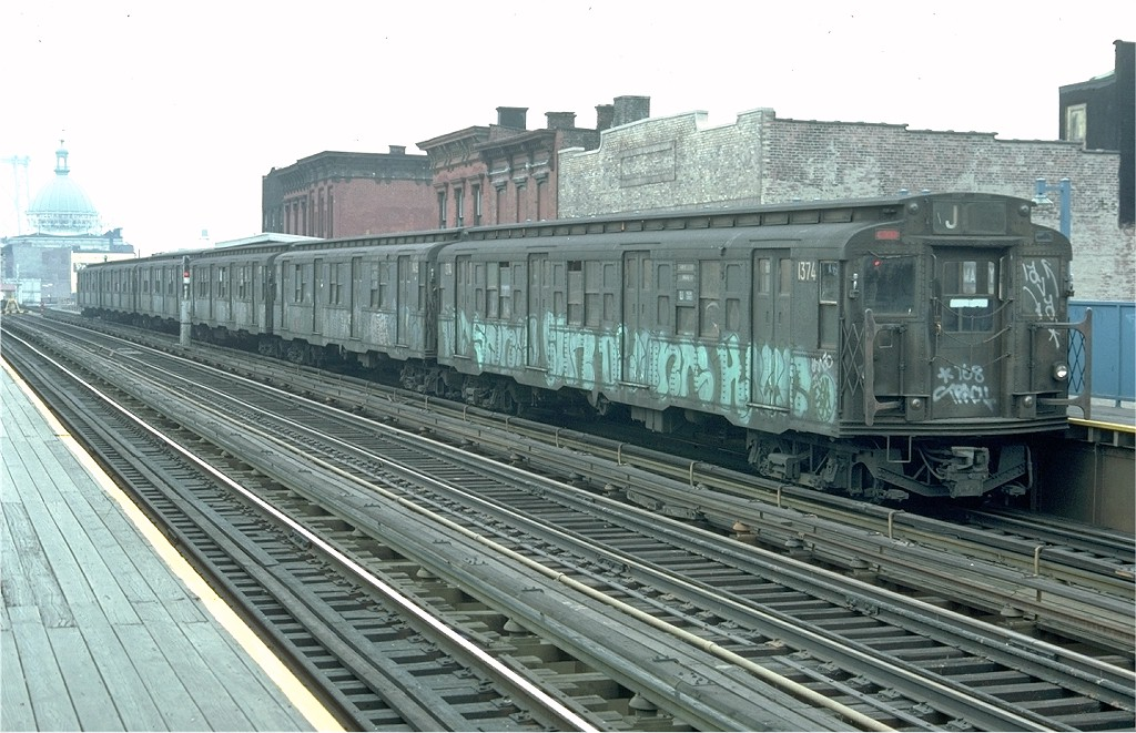 (211k, 1024x661)<br><b>Country:</b> United States<br><b>City:</b> New York<br><b>System:</b> New York City Transit<br><b>Line:</b> BMT Nassau Street/Jamaica Line<br><b>Location:</b> Marcy Avenue <br><b>Route:</b> J<br><b>Car:</b> R-6-1 (Pressed Steel, 1936)  1374 <br><b>Photo by:</b> Doug Grotjahn<br><b>Collection of:</b> Joe Testagrose<br><b>Date:</b> 11/27/1976<br><b>Viewed (this week/total):</b> 0 / 4363