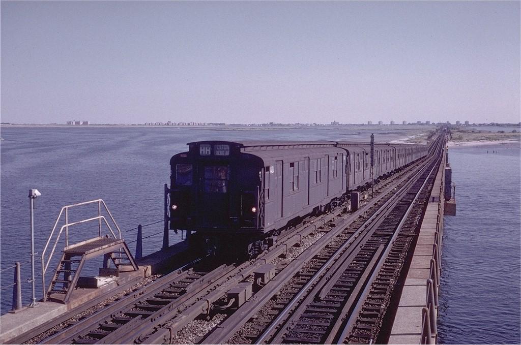 (209k, 1024x679)<br><b>Country:</b> United States<br><b>City:</b> New York<br><b>System:</b> New York City Transit<br><b>Line:</b> IND Rockaway<br><b>Location:</b> North Channel Bridge <br><b>Route:</b> HH<br><b>Car:</b> R-7 (American Car & Foundry, 1937)  1409 <br><b>Photo by:</b> Steve Zabel<br><b>Collection of:</b> Joe Testagrose<br><b>Date:</b> 9/10/1972<br><b>Viewed (this week/total):</b> 1 / 4461