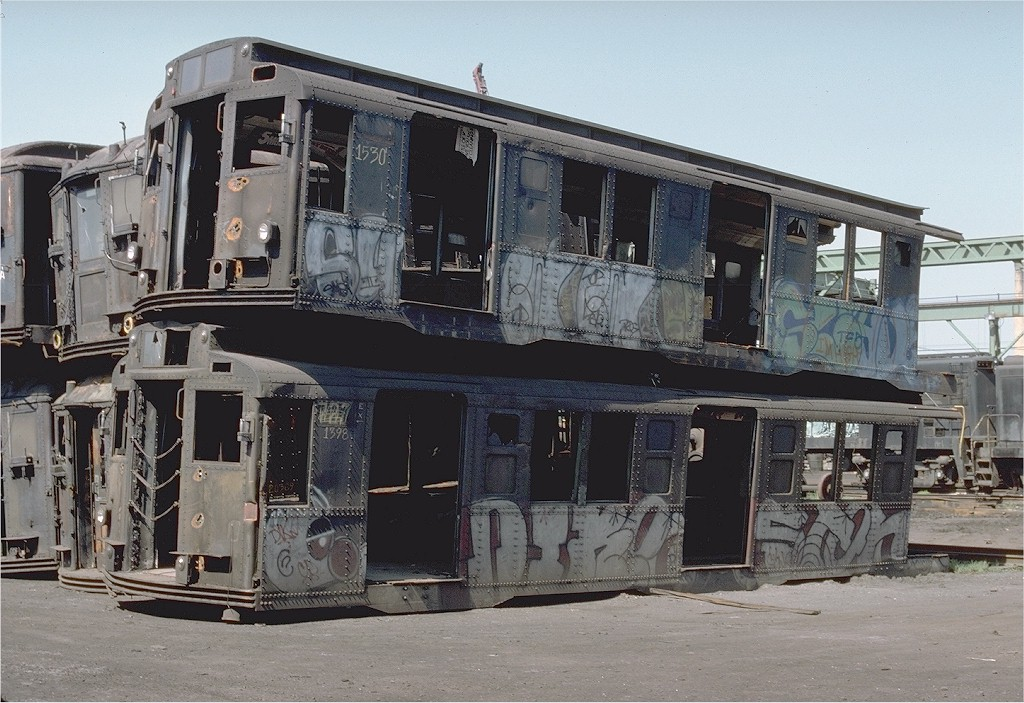 (219k, 1024x703)<br><b>Country:</b> United States<br><b>City:</b> New York<br><b>System:</b> New York City Transit<br><b>Location:</b> Scrapyard<br><b>Car:</b> R-7 (Pullman, 1937)  1530 <br><b>Photo by:</b> Ed McKernan<br><b>Collection of:</b> Joe Testagrose<br><b>Date:</b> 5/29/1977<br><b>Viewed (this week/total):</b> 4 / 12002