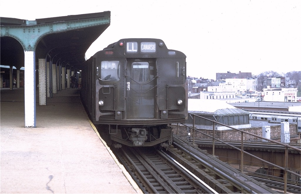(161k, 1024x661)<br><b>Country:</b> United States<br><b>City:</b> New York<br><b>System:</b> New York City Transit<br><b>Line:</b> BMT Canarsie Line<br><b>Location:</b> Broadway Junction <br><b>Route:</b> L<br><b>Car:</b> R-7A (Pullman, 1938)  1575 <br><b>Photo by:</b> Doug Grotjahn<br><b>Collection of:</b> Joe Testagrose<br><b>Date:</b> 4/10/1971<br><b>Notes:</b> R10 prototype<br><b>Viewed (this week/total):</b> 7 / 3543