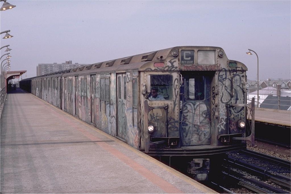 (175k, 1024x683)<br><b>Country:</b> United States<br><b>City:</b> New York<br><b>System:</b> New York City Transit<br><b>Line:</b> IND Rockaway<br><b>Location:</b> Beach 90th Street/Holland <br><b>Route:</b> C<br><b>Car:</b> R-10 (American Car & Foundry, 1948) 2977 (ex-1830)<br><b>Photo by:</b> Eric Oszustowicz<br><b>Collection of:</b> Joe Testagrose<br><b>Date:</b> 4/2/1987<br><b>Viewed (this week/total):</b> 6 / 6513