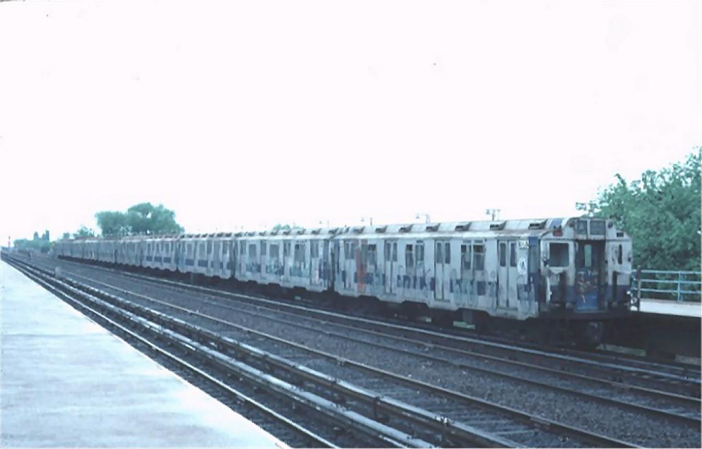 (96k, 1024x655)<br><b>Country:</b> United States<br><b>City:</b> New York<br><b>System:</b> New York City Transit<br><b>Line:</b> IND Rockaway<br><b>Location:</b> Aqueduct/North Conduit Avenue <br><b>Route:</b> A<br><b>Car:</b> R-10 (American Car & Foundry, 1948) 3033 <br><b>Photo by:</b> Ed McKernan<br><b>Collection of:</b> Joe Testagrose<br><b>Date:</b> 5/17/1976<br><b>Viewed (this week/total):</b> 1 / 3929