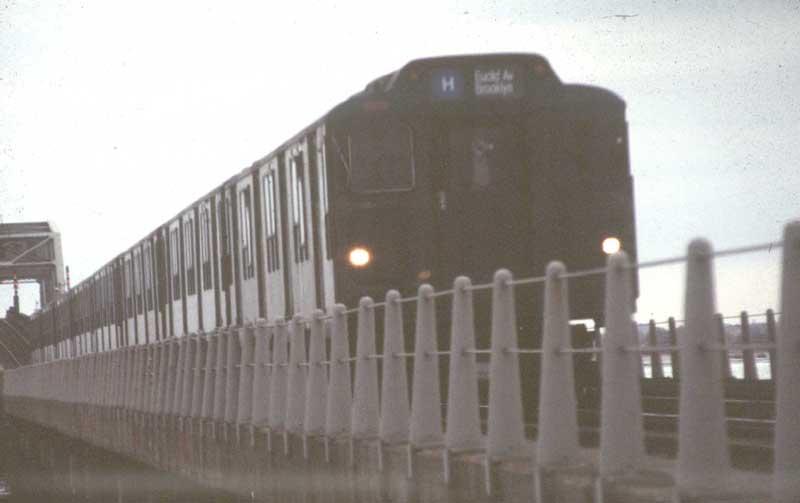 (28k, 800x503)<br><b>Country:</b> United States<br><b>City:</b> New York<br><b>System:</b> New York City Transit<br><b>Line:</b> IND Rockaway<br><b>Location:</b> Jamaica Bay Crossing<br><b>Route:</b> H<br><b>Car:</b> R-10 (American Car & Foundry, 1948) 3141 <br><b>Photo by:</b> Harold<br><b>Date:</b> 4/1988<br><b>Notes:</b> With normal storm door<br><b>Viewed (this week/total):</b> 3 / 5593