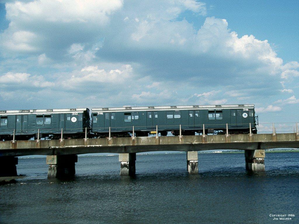 (162k, 1024x768)<br><b>Country:</b> United States<br><b>City:</b> New York<br><b>System:</b> New York City Transit<br><b>Line:</b> IND Rockaway<br><b>Location:</b> Jamaica Bay Crossing<br><b>Route:</b> A<br><b>Car:</b> R-10 (American Car & Foundry, 1948) 3166 <br><b>Photo by:</b> Jim Maurer<br><b>Date:</b> 1986<br><b>Notes:</b> Crossing Jamaica Bay<br><b>Viewed (this week/total):</b> 2 / 13838