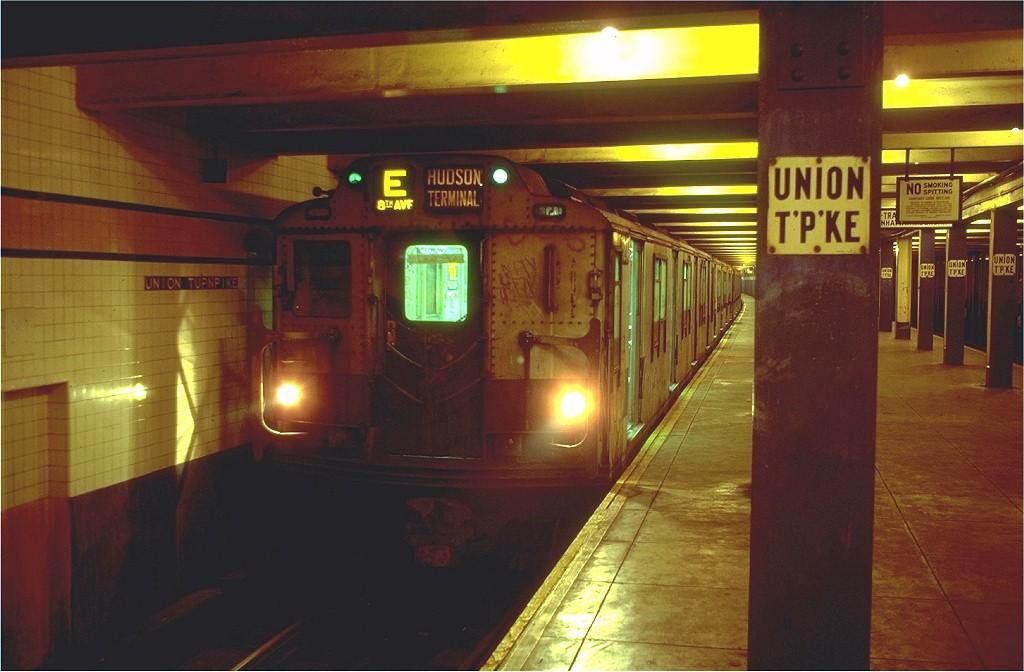 (157k, 1024x672)<br><b>Country:</b> United States<br><b>City:</b> New York<br><b>System:</b> New York City Transit<br><b>Line:</b> IND Queens Boulevard Line<br><b>Location:</b> Union Turnpike/Kew Gardens <br><b>Route:</b> E<br><b>Car:</b> R-10 (American Car & Foundry, 1948) 3214 <br><b>Photo by:</b> Doug Grotjahn<br><b>Collection of:</b> Joe Testagrose<br><b>Date:</b> 8/14/1980<br><b>Viewed (this week/total):</b> 9 / 8760