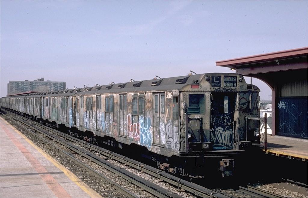 (188k, 1024x659)<br><b>Country:</b> United States<br><b>City:</b> New York<br><b>System:</b> New York City Transit<br><b>Line:</b> IND Rockaway<br><b>Location:</b> Beach 90th Street/Holland <br><b>Route:</b> C<br><b>Car:</b> R-10 (American Car & Foundry, 1948) 3302 <br><b>Photo by:</b> Eric Oszustowicz<br><b>Collection of:</b> Joe Testagrose<br><b>Date:</b> 4/3/1987<br><b>Viewed (this week/total):</b> 6 / 5893